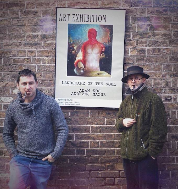 The artists with the exhibition poster - Landscape of the Soul in Dublin